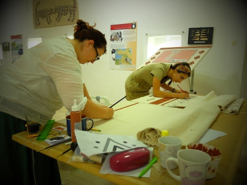 Kerrie and Gozde preparing materials for the Visitor's Centre in 2014. Photo by me.
